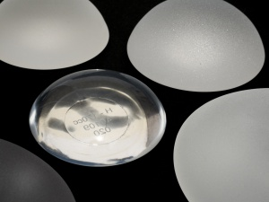silicone breast implants micro textured and smooth surface isolated on black background