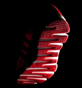 Sneaker sole, view of a falling foot from below..